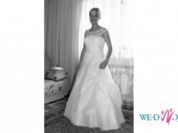 Sprzedam suknię ślubną w kolorze białym