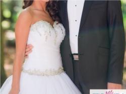 Sprzedam wyjątkową suknię ślubną z pięknym trenem odpinanym na zamek