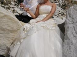Suknia ślubna ecru ze złotą aplikacją rozm 38