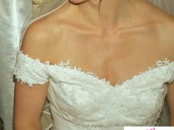 Wdzięczna suknia ślubna 38
