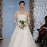 biała suknia ślubna Oscar de la Renta z koronkowymi rękawami