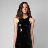 czarna sukienka wieczorowa Bershka błyszcząca - zima 2011/2012