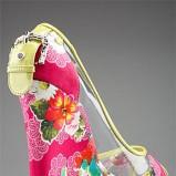 kolorowe pantofle Dolce&Gabbana w kwiaty na koturnie