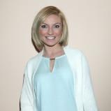 Marzena Sienkiewicz w miętowej bluzce