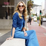 niebieska sukienka Reserved długa - moda 2012