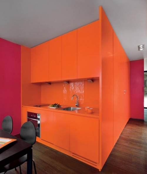Luxury-modern-kitchen-furniture-with-orange-polished-kitchen-cupboards-small-work-top-sink-and-oven