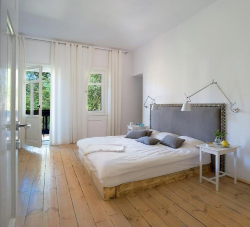 Luxury-bedroom-design-with-modern-double-with-bedding-and-headboard-night-table-and-parquet