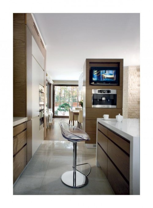 Luxury-kitchen-area-with-modern-island-with-cupboards-and-white-countertop-glass-bar-stool-and-modern-stoves