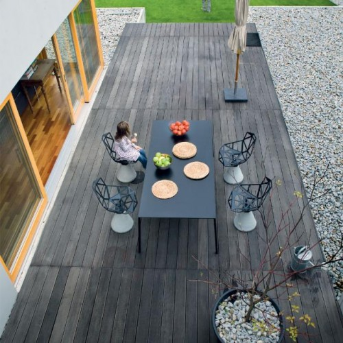 Luxury-amazing-outdoor-furniture-set-with-luxury-modern-shaped-chairs-modern-dark-table-and-wooden-floor