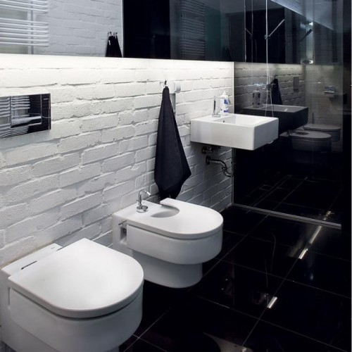 Luxury-minimalist-bathroom-design-with-white-washbasin-sink-modern-toilet-bowl-and-porcelain-bidet