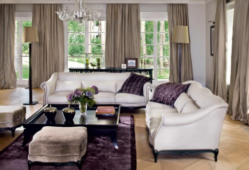 Luxury-living-room-design-with-elegant-two-sofas-modern-coffee-table-stools-and-purple-carpet