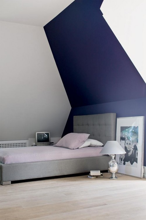Luxury-single-bedroom-with-cute-soft-single-bed-with-headboard-attic-ceiling-and-wooden-floor