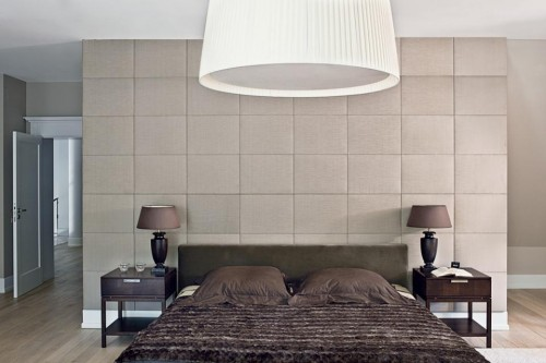 Luxury-master-bedroom-with-double-bed-with-brown-bedding-cute-bedside-tables-and-large-lamp