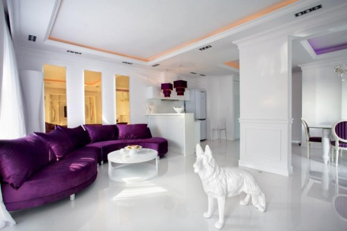 Luxury-living-room-design-with-modern-shaped-sofa-with-pillows-coffee-table-and-white-dog-statue