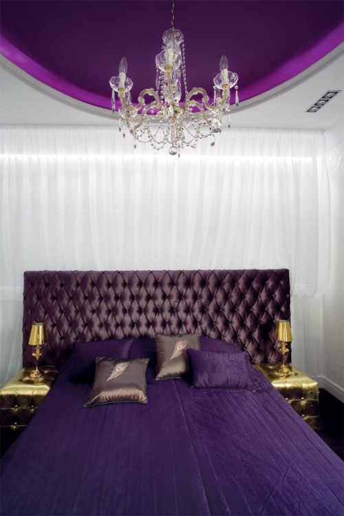 Luxury-purple-master-bedroom-with-headboard-modern-double-bed-with-bedding-and-gold-bedside-tables