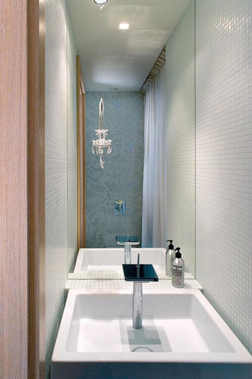 Luxury-bathroom-design-with-modern-contemporary-washbasin-porcelain-sink-and-modern-mirror
