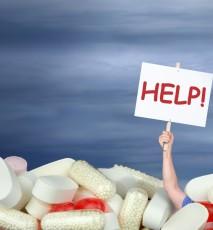 Dużo tabletek, tabliczka HELP