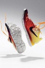 obuwie sportowe Nike w kolorze pomara�czowo - ��tym - lato 2013